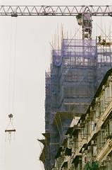 Non stop construction in Hong Kong (TAHUSA) Tags: hong kong hk nikon f100 film agfaphoto agfa vista 200 nikkor 135mm f2 dc nikon135mmf2dc colour negative c41 filmphotography bokeh street photography iso200