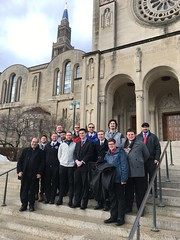 Fr. Kesicki and seminarians at the Basilica of the National Shrine of the Immaculate Conception, January 21, 2019, standing on the steps where Pope Francis celebrated the outdoor Canonization Mass of St. Junipero Serra in 2015.