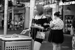 Secrets (McLovin 2.0) Tags: street candid smoking girl smoke cigarette streetphotography urban city melbourne monochrome bw sony a7s 55mm zeiss bokeh shopping style fashion