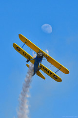 Flirting with the moon (vortex_generators) Tags: aviation airplanes aviazione airshow aerei aviationphotography aerobatics aircraft biplane plane propellers oldtimer warbird stearman smoke moon flying flyparty