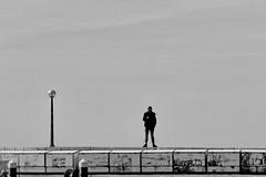 singleplayer (heinzkren) Tags: schwarzweis blackandwhite bw sw monochrome people solo panasonic lumix man lamp sky street streetphotography candid piran kai slo quay person individual human silhouette minimal minimalism