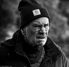 Ready for the weather. (Neil. Moralee) Tags: neilmoralee skye2019 man portrait face candid old mature sour unhappy cold hat beany woolen wooly moustache street skye isle island glasses black white bw bandw blackandwhite mono monochrome neil moralee scotland britain uk olympus omd em5 winter outdoor people carhartt pensioner senior scotsman islander