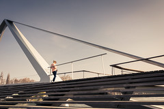 Waiting in the sun (Gilderic Photography) Tags: liege belgium belgique bridge pont passerelle girl waiting city architecture sunny telephone spring