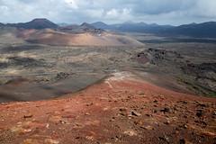 Volcanic scenery (piotr_szymanek) Tags: lanzarote outdoor volcano blue sky lava landscape clouds mountains 1k 20f