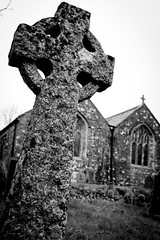 2019_013 (Chilanga Cement) Tags: fuji fujix100f fujifilm fujix xseries x100f 100f stone church grave graveyard monochrome bw blackandwhite clouds grass religion belief cross