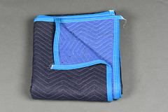 A Black and Blue Moving Blanket (hireahelper) Tags: furniture blanket moving pad mover relocate black blue grey shadow backdrop fabric