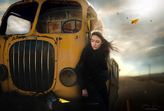 Broken Vessel ({jessica drossin}) Tags: jessicadrossin portrait woman bus yellow sky blue road open alone paper airplane broken rusty desert wind travel lost wwwjessicadrossincom