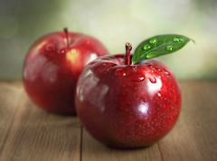 Fresh and crisp! (Through Serena's Lens) Tags: lookingcloseonfriday apples fruit closeup dof bokeh stilllife droplets tabletop red