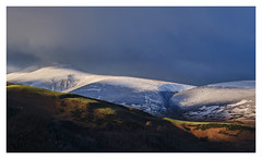 Golden Light on Skiddaw, The Lake District (dandraw) Tags: skiddaw thelakedistrict thelakes cumbria snow winter outdoors adventure mountains keswick clouds sky drama dramatic atmospheric lightsource lighting goldenhour sunlight landscape lakedistrict saddleback fuji fujifilm xt3