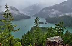 Low Clouds on an Overcast Day in the North Cascades Mountains of Washington (North Cascades National Park Service Complex) (thor_mark ) Tags: azimuth283 capturenx2edited cascaderange centralnorthcascades clouds cloudsabove cloudsabovetrees cloudsacrossvalley cloudsaroundmountainpeaks cloudsaroundmountains cloudsinvalley cloudy colorefexpro davispeak day7 diablolake diablolakevistapoint eldoradomassif evergreentrees evergreens hiddeninclouds hillsideoftrees lake landscape lightdrizzle lookingwest lowclouds mountainpeak mountains mountainsindistance mountainsoffindistance nature nikond800e northcascades northcascadeshighway northcascadesnationalparkcomplex northcascadesnationalparkservicecomplex northcascadesscenichighway outside overcast overcastwithclouds pacificranges picketrange portfolio project365 rainy rainyday ridge ridges rollinghillsides rosslakenationalrecreationarea skagitrange trees triptonorthcascadesandwashington wastateroute20 rosslakenationalrecreationar washington unitedstates