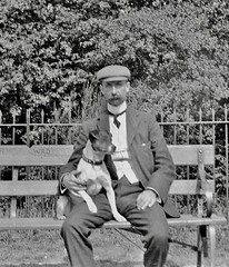 Man and dog sitting on a bench (vintage ladies) Tags: vintage blackandwhite photograph photo man male dog sitting seat bench cap moustache 20s 20sman