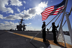 Sailors bring down the American flag as USS Carl Vinson gets underway. (mrbell36617) Tags: sailors warfighters warfighting fast flexible worldwide deployed onwatch preservepeace deteraggression defendfreedom heritage operateforward beready tradition freedom protect commerce sealanes liberty navy usnavy america unitedstates military warfightingfirst nmcs navymediacontentservice chinfo sandiegobay