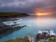 Galley Head (Des Daly) Tags: sunset headland water cork sunburst evening atlantic