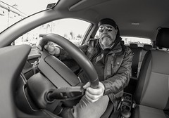 Driver. (CWhatPhotos) Tags: cwhatphotos olympus penf m zuiko 8mm prime lens f18 four thirds wide angle fisheye fish eye view digital camera photographs photograph pics pictures pic picture image images foto fotos photography artistic that have which with contain artistc art light auto automobile car white hyundai i20 12se 12 se vehicle 2017 new brand man male driver driving interior goatee leather black docker dockers cap jill corbett hatic brighton flickr