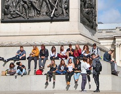 Tourists (Waterford_Man) Tags: london group teens tourists girl boy jeans phone mobile candid street