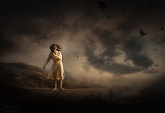 Fly Away ({jessica drossin}) Tags: jessicadrossin portrait photography naturallight sky clouds ravens birds crow woman dress yellow dark ominous hills shadows wwwjessicadrossincom