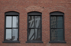 trio (Karen Juliano) Tags: denver brick building architecture windows three trio reflection arched glass pane symmetry