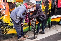 Bristol; February 2019 (Daniel Durrans) Tags: streetphotography streetart sign urban son candid argument street bristol father colourful graffiti colourpop family canpubphoto colour