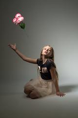 xaina-364.jpg (tcmono@att.net) Tags: child flowers throwingflowers littlegirl girl kneeling canon6d 6d canon tamronlens tamron