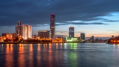 Evening on a pond in the center of the city (Berilyon) Tags: yekaterinburg evening pond city illumination travel architecture building center tower blue cityscape reflection river sky water cloud high summer urban view panorama autumn office centre lake bridge ural sunrise ekaterinburg boat