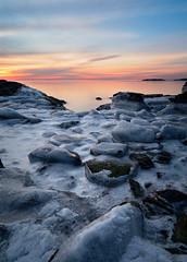 Groundhog Day Sunrise (Ralph Cherubin) Tags: olympus ep5 panasonic 12mm32mm february 2019 westhaven connecticut ct winter ice water sunrise rocks morning cold beach