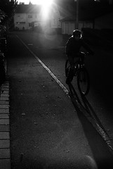 A cold ride (Leica M6) (stefankamert) Tags: light cold bicycle people backlight analog analogue film grain shadows noir blackandwhite blackwhite noiretblanc lines leica m6 leicam6 voigtländer nokton 35mm kodak trix textures street stefankamert