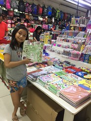at the stationer's (ghostgirl_Annver) Tags: asia asian girl annver teen preteen child kid daughter sister family portrait stationers shop coloring book pencil