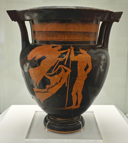 Athenian Red Figure column krater representing a javelin-thrower awarded with fillets by two Nikai