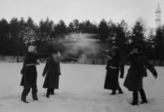 Snowball fight (Sonofsono) Tags: snow film finland soviet gp5 gas mask postapocalyptic apocalyptic apocalypse winter graflex speedgraphic fomapan trench coat black bw white