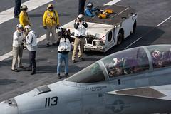 Civilian media capture visual imagery of an F/A-18F Super Hornet aboard USS John C. Stennis (CVN 74). (Official U.S. Navy Imagery) Tags: ussjohncstennis cvn74 uscentcom fa18fsuperhornet distinguishedvisitors arabiangulf