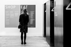 The Dilemma (DobingDesign) Tags: blackandwhite person lines text signage wayfinding secondfloor contrast elevators woodenfloor choosing options choices shoporeat navigation fulfillment contentment hungry dilemma roadtohappiness crossroads activities decisions decide