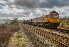 GBRf Class 66/7 no 66763 just after Sutton-in-Ashfield Station on 14-03-2019 with the Wellingborough to Tilcon Empties. (kevaruka) Tags: 37 syphon growler 37402 37425 drs direct rail services nuclear waste cnd british network english electric mansfield nottinghamshire winter 2019 march kevin frost gloom dull dreary day rain rainy railway railfreight trains train clouds cloudy cold flickr front page thephotographyblog telephoto canon eos 5d mk3 ef100400 f4556l 5d3 5diii colour colours color colors blue yellow outdoor railroad locomotive tree sky people photoadd boobs milf sexy wife