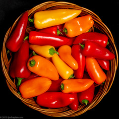 A Basket o' Peppers (Jim Frazier) Tags: 2019 20190322peppers elgin alienbees basket beautiful beauty blackbackground buds bunch centered centralperspective circles closeup detail edgewater flash flora frazier fruits fruitseedpods group headon home house il illinois interior jimfraziercom kane kanecounty linedup march nature orange our peppers perpendicular pods pov produce q4 radials raw red rounds setup shootthroughumbrella square squaredcircle stilllife studio study symmetrical symmetry tabletop texture vegetables wheels winter worldfamousfrazierstudio yellow f10 instagram