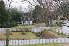A March Winter Day (danicalees) Tags: williamsburg virginia colonial march 2013 overcast cloudy trees green grass fence building winter sidewalk yard nature