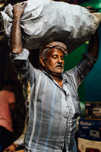 Man Carrying Heavy Bag on Head, Varanasi India