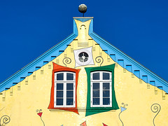 Joyful facade (Ulrich Neitzel) Tags: architecture architektur bemalt colour colourful farbig fenster gable giebel mzuiko14150mm olympusem1 painted window facade fassade
