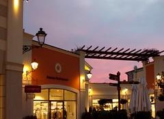 Shops in the night (simonsz@rocketmail.com) Tags: design outlet castelromano sunset evening shopping roman roma rome cheap stilisti stylists moda fashion michaelkors versace moschino valentino cavalli trussardi burberry nike barato scontato conveniente designer