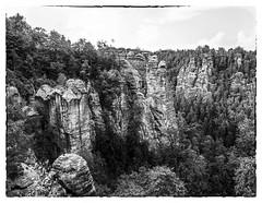 erosion (2) (kurtwolf303) Tags: elbsandsteingebirge kurtwolf303 monochrome sw bw mountains berge wald forest trees felsen rocks sachsen saxony sächsischeschweiz germany deutschland sky himmel frame fotorahmen omd mft olympusem1 microfourthirds landscape landschaft gebirge erosion unlimitedphotos