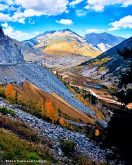 View Back to Silverton Down the Million Dollar Highway, Colorado, USA (Black Diamond Images) Tags: view silverton milliondollarhighway colorado usa cloud clouds milliondollarhwy fallcolor appleiphonex iphonexbackcamera iphonex iphone westernusatrip2018 2018 sky mountain autumncolour autumncolor autumn sanjuanskyway hwy550 tree wood forest landscape road mountainside sanjuanmountains screeslope redmountain aspens colourfultrees co grass field highway550