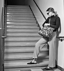 Megan 5 (neohypofilms) Tags: series retro fashion style fun 70s pants slacks shades glasses tall long legs flats mules slippers clogs girl model actress talent bw hasselblad blackandwhite 120 medium format film cinema concept conceptual art stairs steps shoes purse handbag