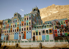Colourful  Buqshan Khaila Hotel, Wadi Doan, Hadramaut, Yemen (Eric Lafforgue) Tags: arabia arabiafelix arabianpeninsula architectural architecture blue bluesky building buqshan buqshanvillage colorful colour colourpicture day hadhramaut hadhramawt hadhramout hadramaout hadramawt historical history horizontal hotel housing multicolored multicolore nopeople palace placeofinterest traditionalarchitecture village wadidoan yemen 0106yemenlafforgue