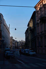 Cyclist (Michal Zawolek) Tags: krakow kraków krakau krakov cracow cracovia street streetphotography building buildings road city cars car traffic crosswalk sky architecture architectural historical historic