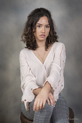 Chrissy's Pick (SteveFrazierPhotography.com) Tags: nikond750 stevefrazierphotography studio portrait portraiture speedlights flash graybackdrop painted photographer pose posing younglady longhair sitting seated handscrossed gray beautiful attractive