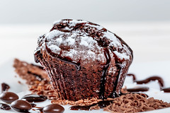 Chocolate muffin with chocolate pieces and icing on white background (wuestenigel) Tags: sugar bake muffin dessert sweet brown background hazelnut praline cupcake delicious celebration homemade assortment bakery meal baked chocolate group closeup icing breakfast temptation gourmet cake confectionery food crushed ingredient nutrition dark chopped cookies black tasty fresh snack pastry white