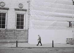 Past the Post, Aberdeen, April 2016 (Mano Green) Tags: post man old scaffold city street black white people person aberdeen scotland uk spring april 2016 lomo smena symbol ilford xp2 super 400 35mm film