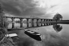Serenity interrupted by dark clouds (malioli) Tags: bridge boat river water sky clouds bw bnw blackyndwhite monochrome korana karlovac croatia hrvatska europe canon