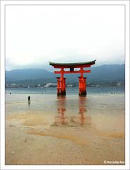 Torii (RanadipRoy) Tags: torii gate reflection orange outdoor landscape person tourist water bay shore coast miyajima japan