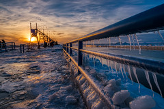 South Haven Lighthouse #7 (tquist24) Tags: hdr lakemichigan michigan nikon nikond5300 people southhaven southhavenlighthouse catwalk clouds cold evening fence frozen geotagged ice icicle icicles lighthouse pier sky sunset water winter