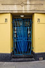 Blue gates at 71 (Paul Perton) Tags: euston london step apartment door flat gate stair street streetphotography urban yellow