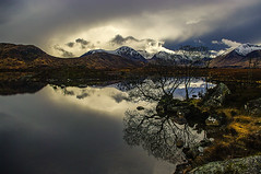 Moody At Loch Ba On Rannoch Moor (Brian Travelling) Tags: scotland pentax pentaxk20d pentaxdal pentaxkr moody reflection water lochba westhighlands highland highlands west sky clouds bushes bush tree moor mountains snow